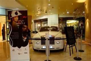 Jen Su & Loyiso Feat. JR banner with Rolls-Royce at Nelson Mandela Square by Flickr user Jennifer Su