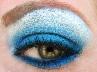 Up close photo of a green eye with blue eyeshadow. mac cosmetics by Flickr user pumpkincat210