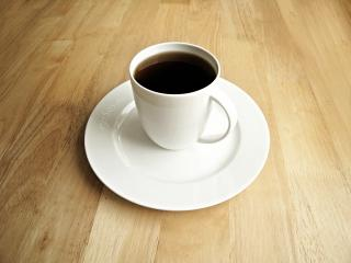Black Coffee for Breakfast in White Porcelain Cup by Flickr user epSos.de