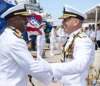 Rear Adm. Frank L. Ponds, left, shakes hands with Rear Adm. Richard L. Wiliams Jr. by Flickr user Official U.S. Navy Imagery