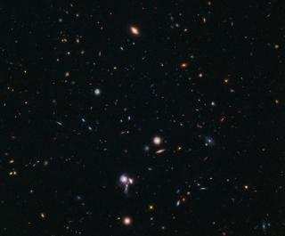 Hubble Pinpoints Farthest Protocluster of Galaxies Ever Seen by Flickr user NASA Goddard Photo and Video