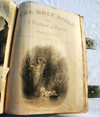 The Holy Bible, a devotional and practical commentary page, illustrated with Moses in the rushes, published 1885 by Flickr user Wonderlane