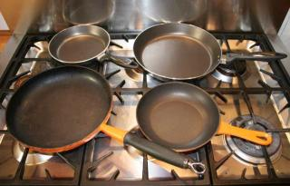 Frying pans by Flickr user cookipediachef
