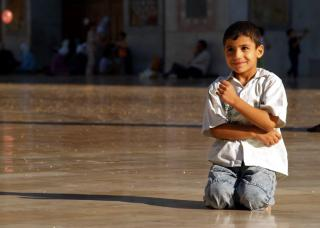 Playful boy in the vast courtyard of the Great Umayyed Mosque of Damascus, Syria by Flickr user james_gordon_losangeles